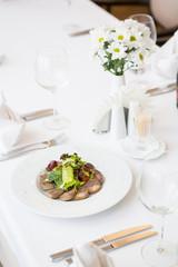 Sliced homemdae sausage on a plate