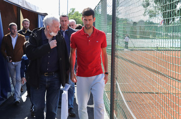 World number one tennis player Novak Djokovic leaves after a news conference, in Belgrade