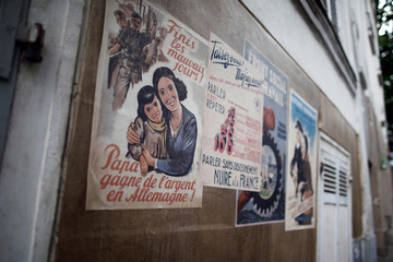 "German propaganda and the Vichy government posters edited for ""Adieu Monsieur Haffmann"", as the shooting will resume following the outbreak of the coronavirus disease (COVID-19) in Paris"