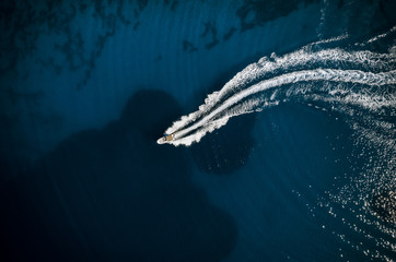 Speed boat in mediterranean sea, aerial view