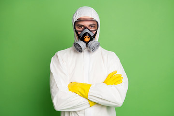 Keuken foto achterwand Texturen Portrait of medical worker man cross hands ready stop covid19 epidemic spreading wear hazmat uniform isolated over green color background