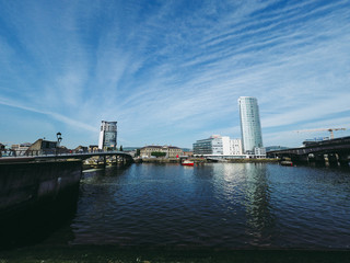 Fototapeta Bridge Over River Against Buildings In City