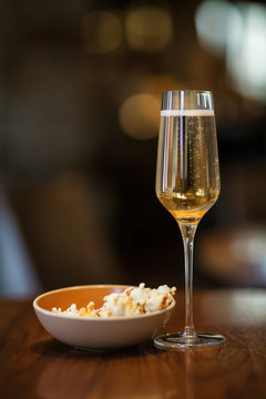 Champagne Flute and Popcorn Bowl in Night Time