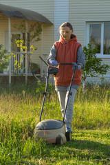 woman in backyard mowing grass lawn mower