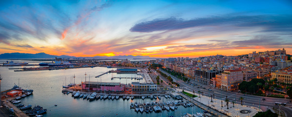 Panoramic view of Cagliari city and harbor at sunset. Aerial panoramic view of Casteddu. Fototapete