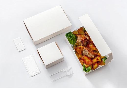 white take away box with chicken and hamburger