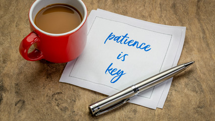 patience is key inspirational note - handwriting on a napkin with a cup of coffee