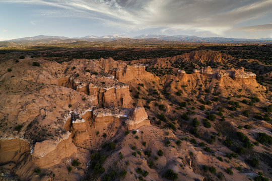 Sunset Aerial photograph of a New Mexico Landscape with Views of dramatic cliffs, mountains, and mesas