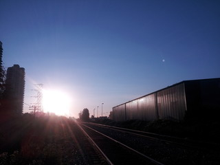 Silhouette Of Railroad Tracks Against Clear Sky