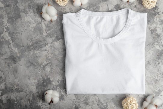 Layout with a white T-shirt Flat lay with cotton flowers, soft and light photo. For placing fonts, logos