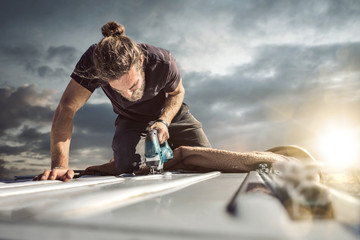 Young man working with a jigsaw