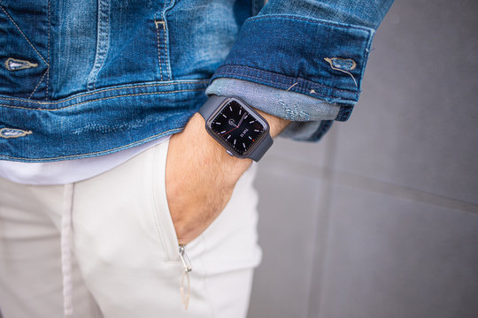 Heidelberg, BW / Germany - 05-12-2020: Close Up of Apple Watch on Stylish Leisure Outfits