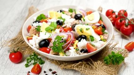 Wall Mural - rice salad with egg, tomato, onion and tuna fish