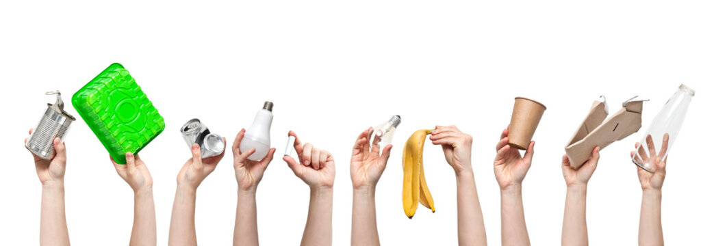 A lot of woman's hands are holding different kind of garbage