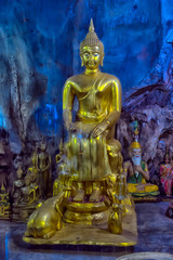 Wat Tham Khao Yoi is a beautiful temple adjacent to the rocky mountains of Phetchaburi Province in Thailand.
