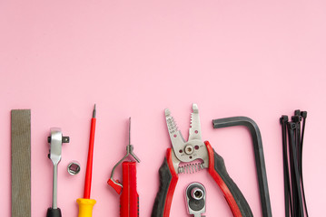 Home maintenance, service, diy concept. Tools for wood, metal and other construction work. Top view on DIY tools. home repairs. on pink background. Wall mural