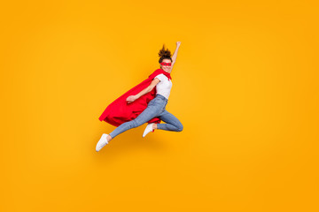 Full length body size view of her she nice attractive lovely strong powerful fit slim cheerful girl jumping wearing mantle flying fast isolated on bright vivid shine vibrant yellow color background