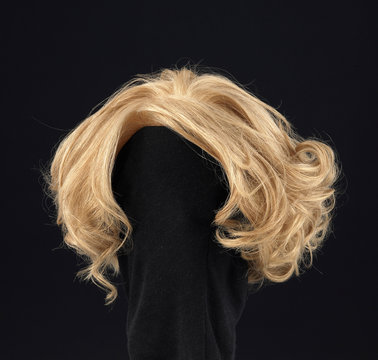 wavy blonde hair wig on black background