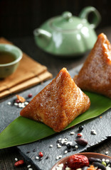 Chinese dragon boat festival food rice dumplings zongzi on green leaf