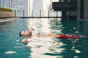Carefree man relax in swimming pool