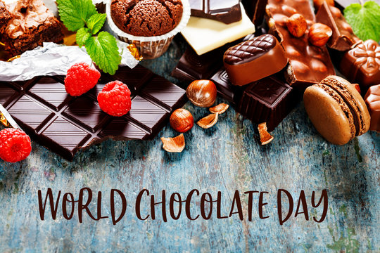 World Chocolate Day concept. Chocolate on blue wooden background
