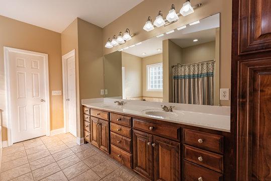 modern bathroom with wood cabinets
