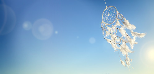 Fototapeta Dream catcher on blue sky background with copy space obraz