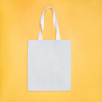 Eco cotton tote bag mock -up on yellow background.
