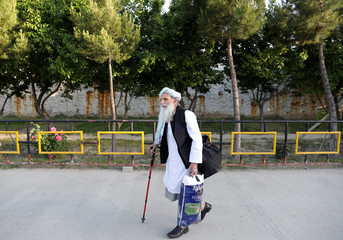 A newly freed Taliban prisoner walks at Pul-i-Charkhi prison, in Kabul, Afghanistan