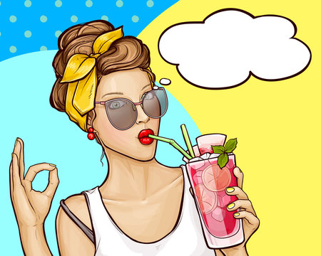 Pop art vector illustration of pretty girl in white t-shirt, sunglasses and headband holding a cocktail in her hand. Beauty woman shows sign OK and drinks refreshing cocktail through a straw.