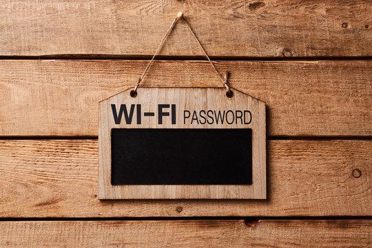 Chalkboard with wifi password sign. Blank wood board