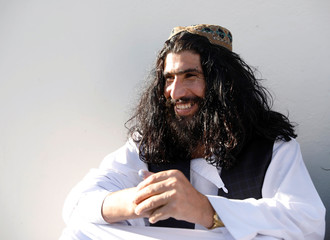 A newly Taliban prisoner sits at Pul-i-Charkhi prison, in Kabul, Afghanistan