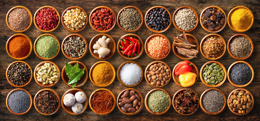 Fototapeta Colourful background from various herbs and spices for cooking in bowls obraz