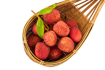 Fototapete - Ripe lychees with green leaves in basketwork isolated on white background with clipping path.