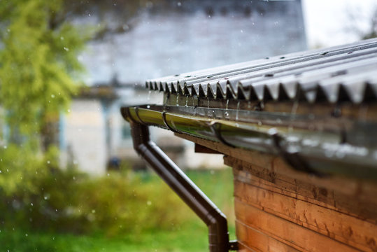 rain flows down from the roof