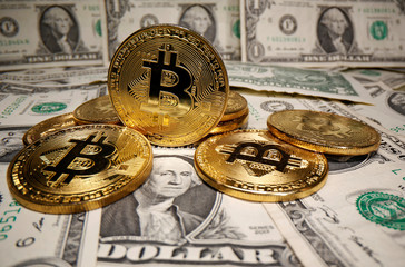 Representations of virtual currency Bitcoin are placed on U.S. Dollar banknotes