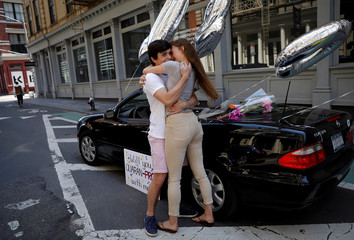 High School student surprises his girlfriend outside her Soho apartment during outbreak of the coronavirus disease (COVID-19) in New York