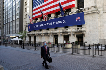 Traders leave New York Stock Exchange after building opened for first time since March while outbreak of the coronavirus disease (COVID-19) continues in New York