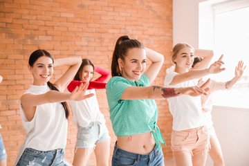 Beautiful young women dancing in studio