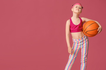 Cute little basketball player on color background