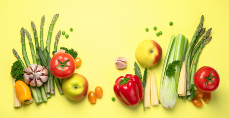Wall Mural - Fresh fruits and vegetables on yellow background