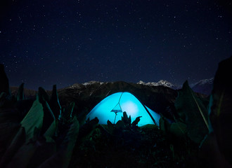 Glowing tent camping in the Night Mountains
