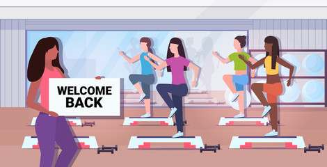 female fitness trainer holding welcome back sign board coronavirus quarantine is ending victory over covid-19 concept gym studio interior horizontal vector illustration