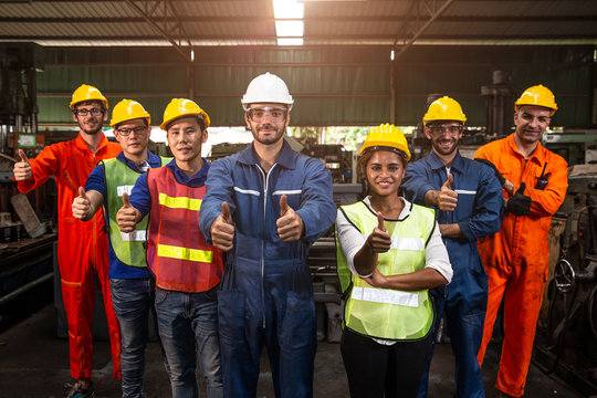 Group of Team Worker mix race  enjoy working in heavy factory standing together smiling happy hand show thumbs up wide banner.