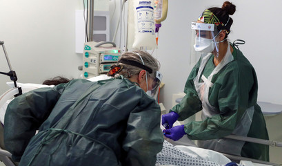 Nurses care for a patient in an Intensive Care ward treating victims of the coronavirus disease (COVID-19) in Frimley Park Hospital in Surrey