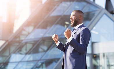 Joyful Businessman Shouting Shaking Fists Standing In City