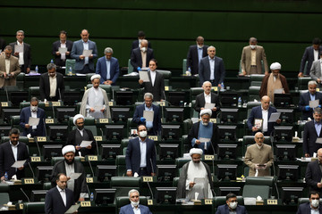 Iranian lawmakers attend the opening ceremony of Iran's 11th parliament, as they practice social distancing measures as the spread of the coronavirus disease (COVID-19) continues, in Tehran