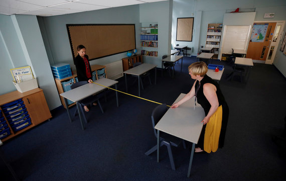 Head teacher Polly Goodson and Deputy Head Claire Cowgill measure the distance between desks in a classroom at St Anne's CE primary school as the spread of the coronavirus disease (COVID-19) continues in Sale