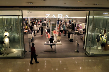 Staff wearing protective mask waits for customers at the entrance of a Zara store, amid the coronavirus disease (COVID-19) outbreak in Kuala Lumpur