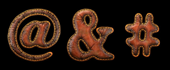 Set of symbols at, ampersand, hash made of leather. 3D render font with skin texture isolated on black background.